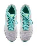 Rinnande skor som isoleras på vit bakgrund arkivbilder