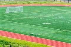 Rinnande spår för fotbollfält royaltyfri foto
