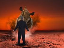 Rinoceronte, hombre de negocios de carga del rinoceronte Imagen de archivo