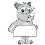 Rinoceronte sveglio che tiene segno in bianco Fotografie Stock