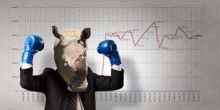 Rinoceronte vestido en traje de negocios Técnicas mixtas Imágenes de archivo libres de regalías