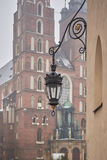 Rinok Square at Krakow. The gas lamp on the background of the Basilica Royalty Free Stock Photos