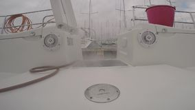 Rinse deck on sailing boat stock video footage
