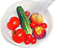 Rinsing fruit. Fruits and Vegetables being washed of dirt and chemicals before eating royalty free stock photos