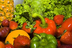 Rinsing fruits and vegetables royalty free stock photos