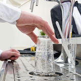 Rinsing a glass Stock Photography