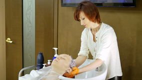 Rinsing the Hair Client in a Beauty Salon stock footage