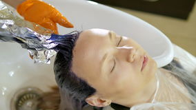Rinsing the Hair Client in a Beauty Salon stock video