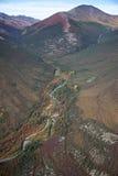 Rio através de um vale da montanha Imagem de Stock