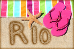 Rio beach vacation concept - flip flops and towel Royalty Free Stock Image