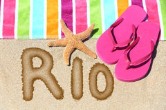 Rio beach vacation concept - flip flops and towel Stock Image