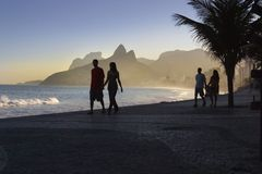 Rio Beachfront couples. Couples on a the beach in Rio Royalty Free Stock Images