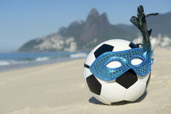 Rio Carnival Football Soccer Ball Wearing Carnival Mask Beach. Soccer theme Rio Carnival football wearing sparkly mask on Ipanema Beach Stock Image