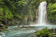 Rio Celeste Falls. Man swimming in the pool just below Rio Celeste Falls,  Costa Rica Stock Image