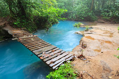 Rio celeste and small wooden bridge Royalty Free Stock Photo