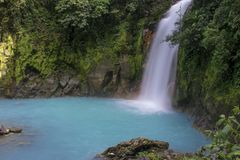 Rio Celeste Waterfall. The blue/green waters of rio celeste is caused by mie scattering Royalty Free Stock Photography