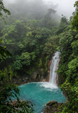 Rio Celeste waterfall in the fog. Costa Rica Royalty Free Stock Photos
