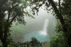 Rio celeste waterfall at foggy day. Tenorio national park Costa Rica Royalty Free Stock Photo