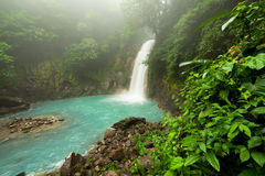 Rio celeste waterfall at foggy day. Tenorio national park Costa Rica Royalty Free Stock Photography