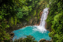 Rio Celeste waterfall in the jungle Royalty Free Stock Photos
