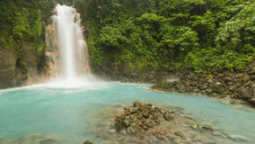 Rio Celeste Waterfall Panorama. Panoramic image of the cerulean blue waters of the Rio Celste Waterfall in Volcan Tenoria National Park, COsta Rica Stock Images