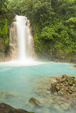 Rio Celeste Waterfall and Sulphurous Rocks. The cerulean blue waters of the Rio Celeste Waterfall in Volcan Tenorio National Park, Costa Rica Stock Photos