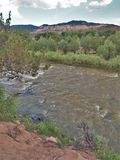 Rio Chama near Abiquiu, New Mexico. Early evening as the Rio Chama flows among the colorful cliffs near Abiquiu, New Mexico stock photos