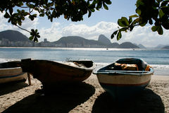 Rio, Copacabana Beach. Fishing boats om the sands of Copacabana beach. Sugar Loaf mountain in the background.Rio de janeiro, Brazil Stock Photography