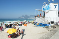 Rio de Janeiro Beach Scene Posto 7. RIO DE JANEIRO, BRAZIL - FEBRUARY 08, 2015: Beachgoers relax on the Beach next to lifeguard tower number 7 at Arpoador Royalty Free Stock Images