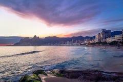 Rio de Janeiro beach skyline at sunset with purple light - Rio de Janeiro, Brazil stock photo