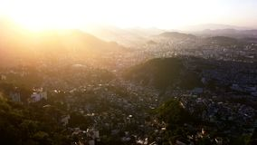 Rio de Janeiro Brazil Aerial video footage of city. narrow streets of the poor favelas house on the hills. Beautiful. Golden hours sunset backlight. he stock video