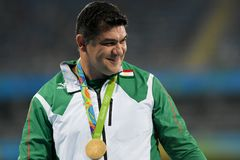 Olympic Games Rio 2016. `Rio de Janeiro, Brazil - august 20, 2016: NAZAROV Dilshod (TJK) gold medal on the podium of the hammer throw during the Olympics royalty free stock image
