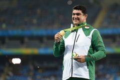 Olympic Games Rio 2016. `Rio de Janeiro, Brazil - august 20, 2016: NAZAROV Dilshod (TJK) gold medal on the podium of the hammer throw during the Olympics royalty free stock photos