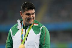 Olympic Games Rio 2016. `Rio de Janeiro, Brazil - august 20, 2016: NAZAROV Dilshod (TJK) gold medal on the podium of the hammer throw during the Olympics stock image