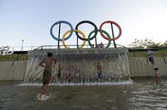 Children play in the water in the Olympic park Royalty Free Stock Photography