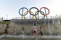 Children play in the water in the Olympic park Royalty Free Stock Images