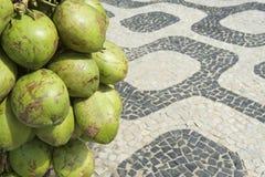 Rio de Janeiro Brazil Coconuts Ipanema Sidewalk. Rio de Janeiro Brazil bunch of fresh green Brazilian coco verde coconuts hanging at Ipanema Beach boardwalk Stock Photo