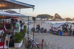 Band playing bossa nova and samba at a kiosk on Copacabana Beach, Rio de Janeiro, Brazil. Rio de Janeiro, Brazil - Dec 17, 2017: Band playing bossa nova and royalty free stock photography