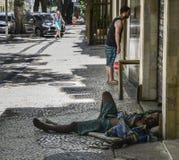 Brazilian homeless man sleeps rough stock photography