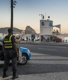 Local Brazilian policemen watch over locals and tourists in Copacabana. Rio de Janeiro, Brazil - Dec 17, 2017: Local Brazilian policemen watch over locals and royalty free stock images