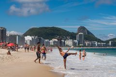 Brazilians Play Football in Copacabana Beach Royalty Free Stock Photography