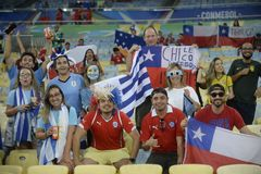 Copa america 2019. RIO DE JANEIRO, BRAZIL - June 24, 2019: Soccer fans celebrating at the 2019 Copa America Group C game between Chile and Uruguay at Maracana stock photo