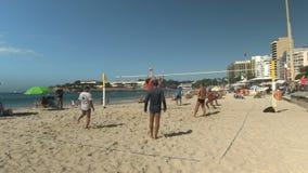 Rio De Janeiro, Brazil- 26, May, 2016: men playing volleyball on Copacabana Beach in Rio De Janeiro stock video footage