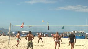 Rio De Janeiro, Brazil- 26, May, 2016: shot of a point being played in a volleyball game on Copacabana Beach in Rio stock footage