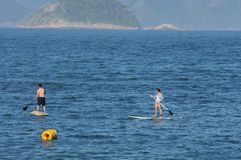 Stand up paddle training. Rio de Janeiro, Brazil,  stand up paddle training on Copacabana  beach Royalty Free Stock Photography