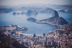Rio de Janeiro, Brazil. Suggar Loaf and Botafogo beach viewed fr. Om Corcovado royalty free stock photos