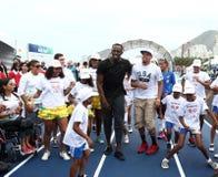 Usain Bolt runs. Rio de Janeiro-Brazil, Usain Bolt runs the 100 meters event during event on Copacabana beach Royalty Free Stock Images