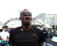 Usain Bolt runs. Rio de Janeiro-Brazil, Usain Bolt runs the 100 meters event during event on Copacabana beach Royalty Free Stock Photos