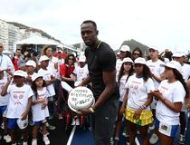 Usain Bolt runs. Rio de Janeiro-Brazil, Usain Bolt runs the 100 meters event during event on Copacabana beach Stock Photos