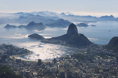 Rio de Janeiro City Skyline Overlook. Rio de Janeiro Brazil scenic overlook view of the dramatic city skyline with shining Botafogo Bay and Sugarloaf Mountain Royalty Free Stock Image
